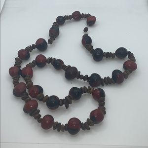 Really cool stand of red and black brown beads